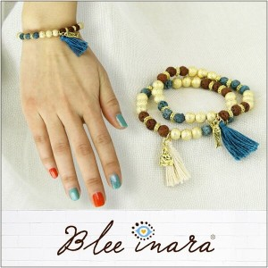 BLEE INARA / ブリーイナラ ブレスレット RED AND BLUE WITH GOLD BEADS BRACELET WITH FISH AND TASSEL