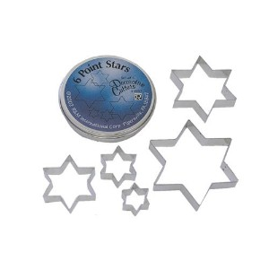 R & M Set of Six Point Stars in Assorted Sizes and a Storage Tin. Range from 5 - 1.5