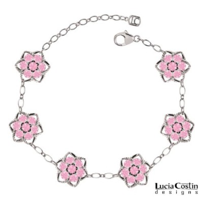 .925 Sterling Silver Star Shaped Flower Bracelet by Lucia Costin with 6 Petal Central Flowers,...