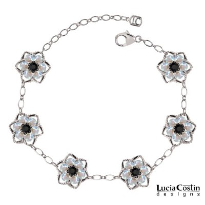 .925 Sterling Silver Star Shaped Flower Bracelet by Lucia Costin with 6 Petal Middle Flowers and...