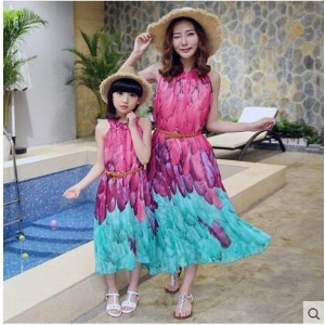 Pretty girl in big girl dress in mother and daughter beach dress in big summer and summer in summer