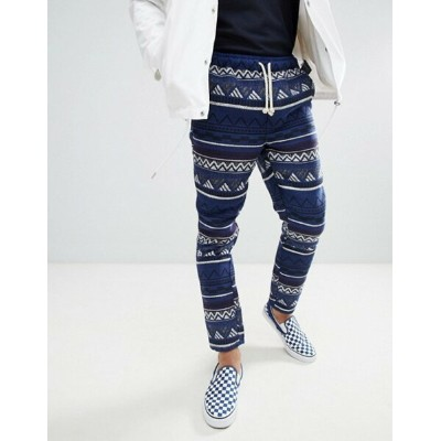 エイソス メンズ カジュアルパンツ ボトムス ASOS DESIGN Festival Tapered Pants In Blue Geo-Tribal Jacquard With...